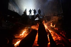 Protesters_on_the_barricades,_seen_through_the_lights_of_fire_built._Euromaidan_Protestssmall